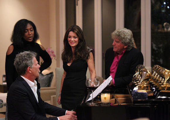 David Foster, Lisa Vanderpump and Ken Todd have piano time.