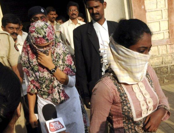 Shaheen Dhada, left, and Renu Srinivas leave a court in Mumbai on Tuesday after being arrested over sentiments they posted on Facebook.