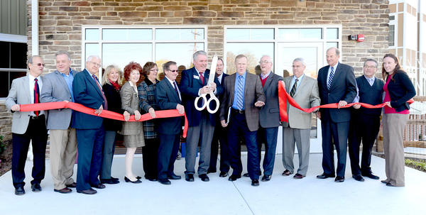 Attending a Nov. 5 dedication and ribbon-cutting ceremony at Woodlands Apartments at Homewood at Williamsport Retirement Center are, from left, Washington County Commissioner William McKinley, Commissioner Jeff Cline, David Miller, Lynn Brumbelow, Linda Hood, Susan Taylor, Conrad Peachey, Rich Lenehan, John Warren, Ernie Angell, David Schwartz, William Wantz, Richard Marshall, Roger Mellott and Jill Reddecliff
