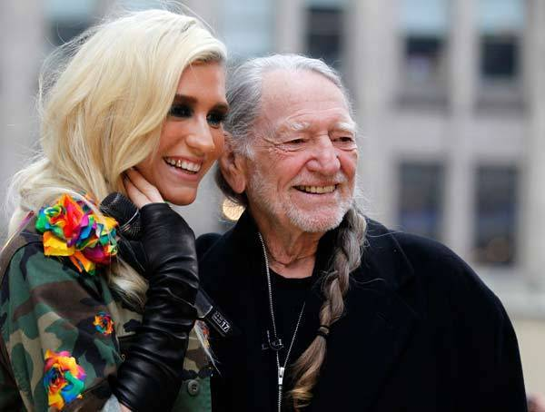 Ke$ha (L) and Willie Nelson pose together during an appearance on NBC's 'Today' show in New York.