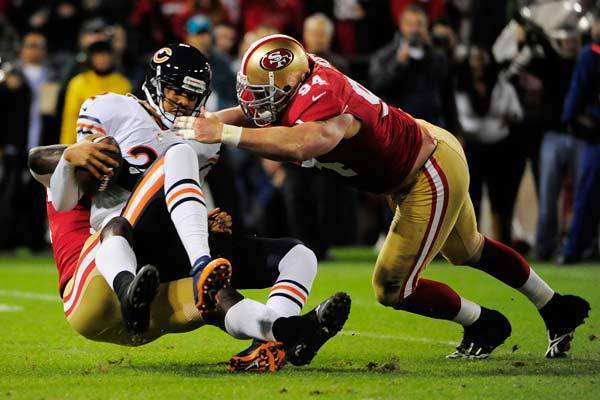 Chicago Bears quarterback Jason Campbell (2, left top) is sacked by San Francisco 49ers outside linebacker Aldon Smith (99, left bottom) and defensive end Justin Smith (94, right) during the first quarter at Candlestick Park.