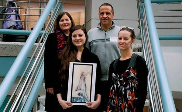 Veronica Severini holds her artwork while standing next to art teacher Dierdre Winklehake-Knuth. Veronica's parents, Diana and Edward Severini, are in the top row.