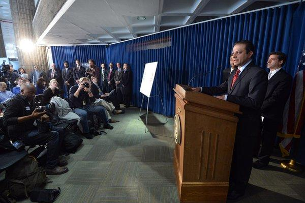U.S. Atty. Preet Bharara in New York announces insider-trading charges against former hedge fund manager Mathew Martoma for an alleged scheme to profit from clinical trial results for an Alzheimer's disease drug.