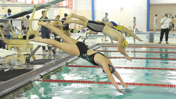 Swimmers bolt into the Otsego County Sportsplex pool Saturday during the Gaylord Gators swim club's home meet against Cadillac and Charlevoix.