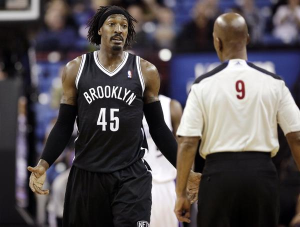 Brooklyn Nets forward Gerald Wallace, left, spars with official Derrick Stafford on Sunday in a game against the Sacramento Kings. The Nets won 99-90 and now face the Lakers tonight.