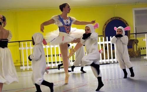 Micaela Abernethy is on pointe as little lambs dance around her during the Connecticut Concert Ballet's rehearsal of the Nutcracker Monday night. The performance will be Dec10th, 11th and Dec. 17th, 18th, at the Bailey Auditorium at Manchester High School. For more info call 860-418-7294 or online at www.connecticutnutcracker.com.