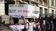College students protest Sec. of State Kris Kobach