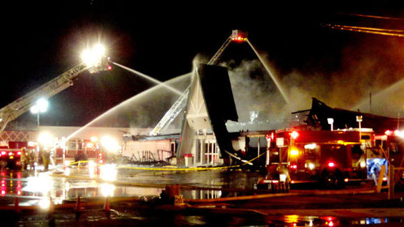 MORE THAN 75 firefighters and emergency personnel from three different counties battled the fire Saturday morning at Alpine Laundry & Dry Cleaners.