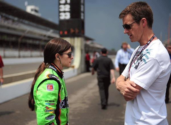Indy Car Series driver Danica Patrick (left) talks with her husband Paul Hospenthal during bump day for the Indy 500 at the Indianapolis Motor Speedway.