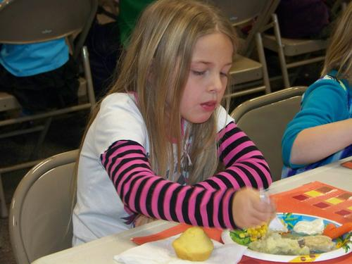 Petoskey Concord second grader, Alexa Tisdale, 7, enjoys her Thanksgiving lunch.
