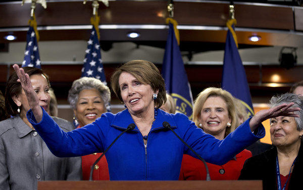 House Minority Leader Nancy Pelosi (D-Calif.), accompanied by female House Democrats, speaks at a news conference on Capitol Hill in Washington.