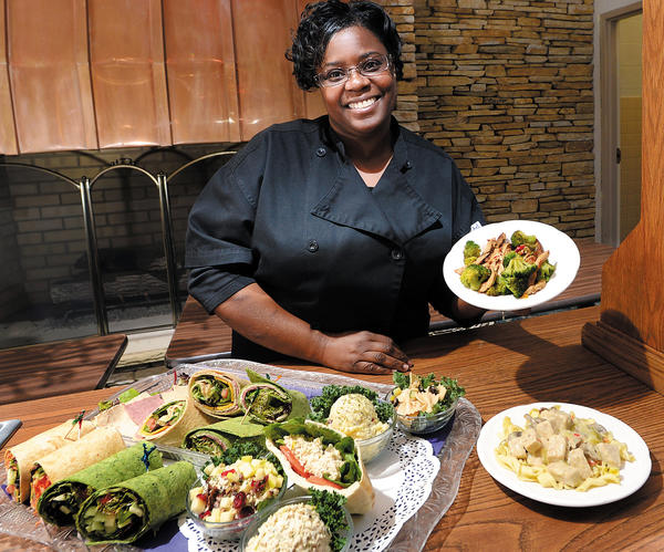 Catrice Davis-Ford, chef at Vegetarian's Pursuit Cafe, shows dishes including mock chicken salads, wraps and pasta dishes using textured vegetarian protein. The cafe is in the Review & Herald Publishing Association plant, south of Hagerstown.