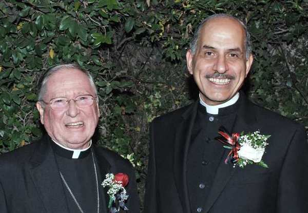 Harvester of Faith honoree Bishop Gerald Wilkerson, left, was greeted by St. Finbar's Father Albert Bahhuth as he arrived at the Los Angeles Equestrian Center.