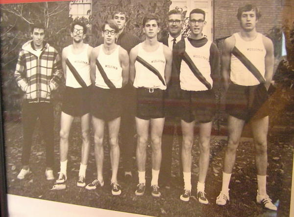 World-class runners Bill Rodgers, third from left, and Amby Burfoot, second from right wearing a dark long-sleeved undershirt, were teammates at Wesleyan University. Here they pose for the 1967 men's cross country team photo.