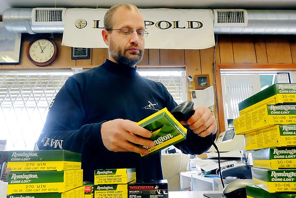 Tim Stahl, owner of Keystone Sporting Goods Inc. in Hagerstown, prices deer ammunition Tuesday in anticipation of the start of the Maryland's firearm deer hunting season on Saturday.