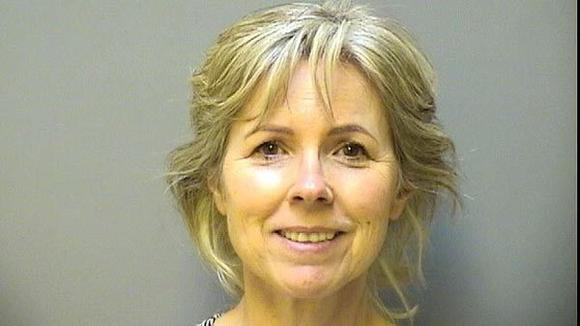 Woman charged with stalking priest