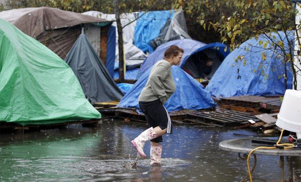 Heavy rains in Seattle flooded this homeless encampment.
