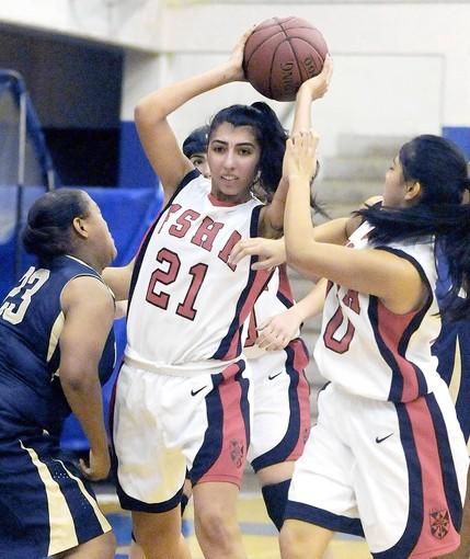 Flintridge Sacred Heart Academy's Melene Agakanian (21) fights for the rebound.