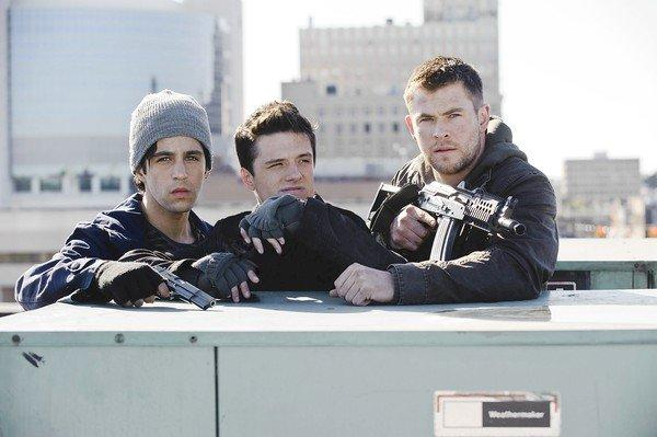 "Josh Peck, left, Josh Hutcherson and Chris Hemsworth star in ""Red Dawn."""