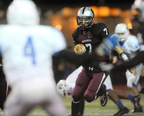 Stroudsburg's QB Mike Nikorak (center) scrambles out of the pocket during their game with Pleasant Valley high School Friday November 2, 2012.