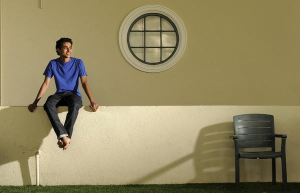 "Actor Suraj Sharma, shown at Fox Studios, seems unfazed by events that led him from a hoped-for lunch date with his brother to stardom thanks to ""Life of Pi."""