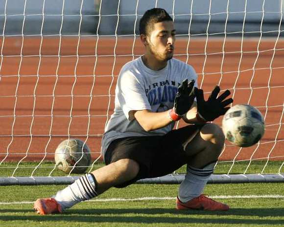 Burbank High goalkeeper Arais Teimoorian makes a save during practice.