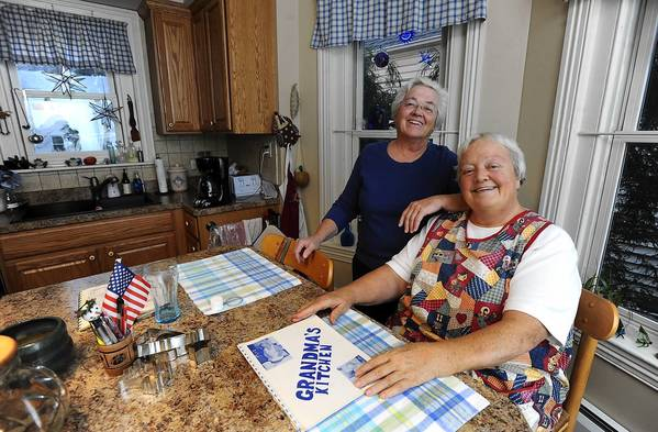 Bernie Mann (left) along with her sister Fern Mann (right) talk about memories of their mother's apron in their Coopersburg kitchen Tuesday November 13, 2012.