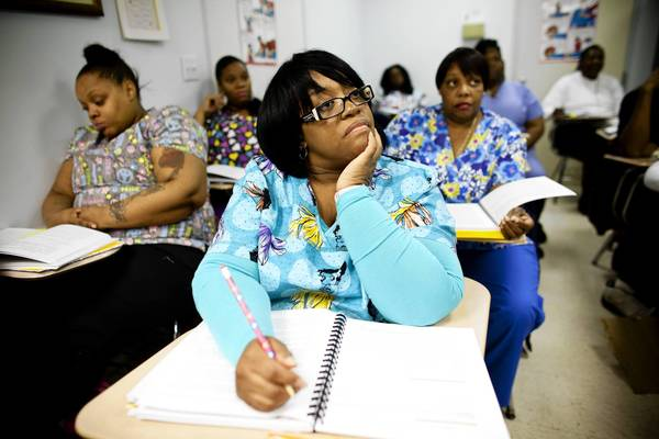 Karen Ross attends a home health aide training class at JVS Chicago. Ross was laid off her construction job a few years ago and is hoping to start 2013 with a new job in the health care field.