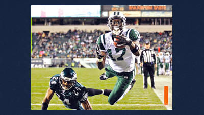 In this Dec. 18, 2011, file photo, New York Jets wide receiver Plaxico Burress (17) catches a pass for a touchdown in front of Philadelphia Eagles cornerback Nnamdi Asomugha (24) during the second half of an NFL football game in Philadelphia. The Pittsburgh Steelers signed Burress on Tuesday to provide depth at a position decimated by injuries.