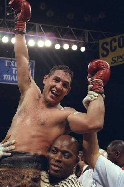 Hector Camacho celebrates after defeating Roberto Duran in Atlantic City, New Jersey, July 22, 1996.