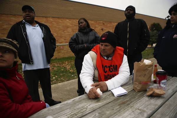 Jose Garcia, seated at center, and other union members in the standoff with Hostess Brands management, strike outside the company's Schiller Park plant Tuesday.