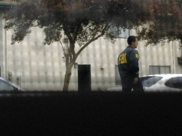 An FBI investigator is outside the home of Upland resident Miguel Santana last week. Santana is one of four men with ties to Southern California who are suspected of a terror plot.