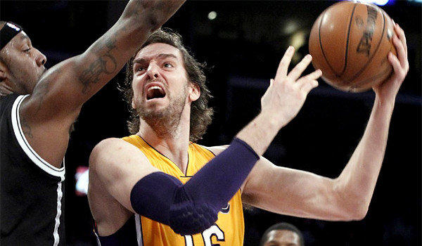 Big man Pau Gasol shoots and scores over Nets forward Andray Batche in the second quarter of the Lakers' 95-90 win Tuesday.