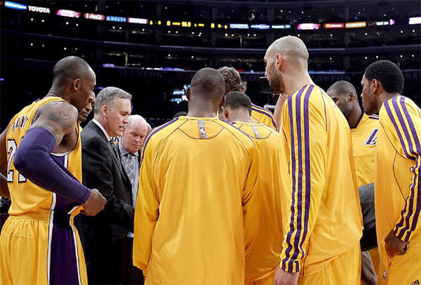 The Lakers huddle around Mike D'Antoni during D'Antoni's first game as the Lakers' head coach.