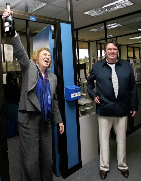 San Diego Union-Tribune publisher David Copley, right, and editor Karin Winner celebrate the newspaper's 2006 Pulitzer Prize for national reporting.