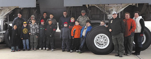Scouts from Pack 34 and Troop 412 toured a C5B Galaxy Aircraft and maintenance facility at the 167th Airlift Wing of the Air National Guard in Martinsburg, W.Va., on Nov. 3. Front row, from left, Javon Boyer, Dane Arasmith, Sean Maguire, Michael Hoffman, Joshua Macias, Drew Hoffman, Mitchell Gearhart, Antonio Roldan, Jeffrey Koogle, Bill Taylor, Michele Taylor and Beth Hoffman. Back row, Ed Calhoun, Christina Morris, Noel Macias, Ryan Maguire, Scot Arasmith, Logan Toms and CMsgt. Robert Gregory.