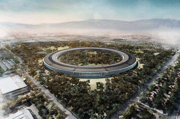 Apple's new proposed headquarters, which looks like a spaceship, is no longer scheduled to open in 2015.