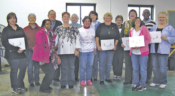 Washington County Free Library employees received service awards at the recent staff training and service awards day. From left, Sally Hull, Jill Craig, Tracy Carroll, Jeff Ridgeway, Lisa Wallace, Donna Chwalek, Beth Cosey, Elizabeth Hulett, Lisa Key, Mary Lou Brooks, Marcella Whitmore, Lisa Bivens, David Johnson and Charlotte Seibert.