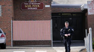 Manchester Police Capt. William Darby walks away from the Manchester High School IOH pool building where an emergency medical incident occured Wednesday morning. I.O.H. stands for The Instructors of the Handicapped Pool and is equipped for handicapped swimmers.