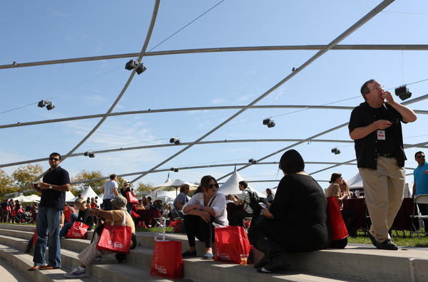 People enjoying the food and wine at the Chicago Gourmet cuisine show at Millennium Park, Saturday Sept., 29, 2012.