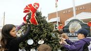 In Manchester, tradition and creativity are fitting ornaments for town tree