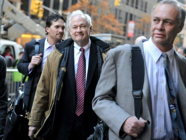 NHL Players' Association executive director Donald Fehr, center, arrives for labor talks at NHL headquarters in New York with his brother, NHLPA counsel Steven Fehr, right, Wednesday.