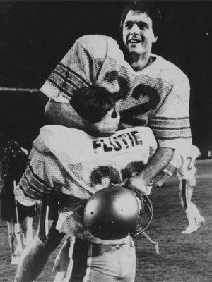 Boston College quarterback Doug Flutie rejoices in his brother Darren's arms after defeating the Miami Hurricanes with a last-second touchdown pass on Nov. 23, 1984.