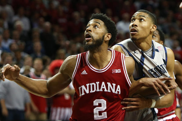 Indiana Hoosiers forward Christian Watford (L) and Georgetown Hoyas forward Otto Porter (R) wait for a rebound during the second half. Indiana won 82-72 in overtime.