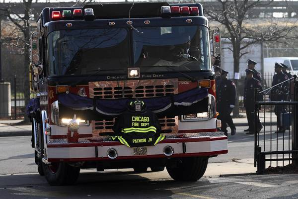 The casket carrying the body of firefighter Walter Patmon Jr. arrives on a fire engine at the Apostolic Church of God, at 6230 S. Dorchester Ave. in Chicago. Patmon, 61, died of a heart attack after returning from a fire call on Nov. 11, 2012.