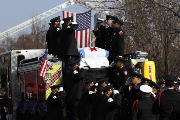 The casket carrying the body of firefighter Walter Patmon Jr. is saluted before being lowered from an engine at the Apostolic Church of God, 6230 S. Dorchester Ave. Patmon, 61, died of a heart attack after returning from a fire call on Nov. 11, 2012.