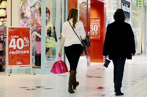 Shoppers are shown Tuesday at Valley Mall near Halfway. Many stores at the mall are planning to open at midnight on the biggest holiday shopping day of the year.