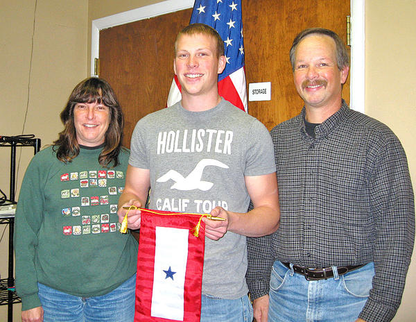 From left, Sheri, Dustin and Doug Williams were presented a Blue Star Service banner from Antietam Unit 236, the Sharpsburg American Legion Auxiliary.