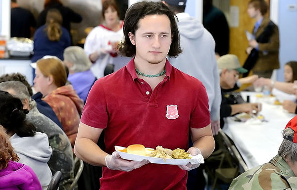 Hagerstown Community College student Colby Hartke serves food Wednesday during the Thanksgiving meal at the Salvation Army in Hagerstown.