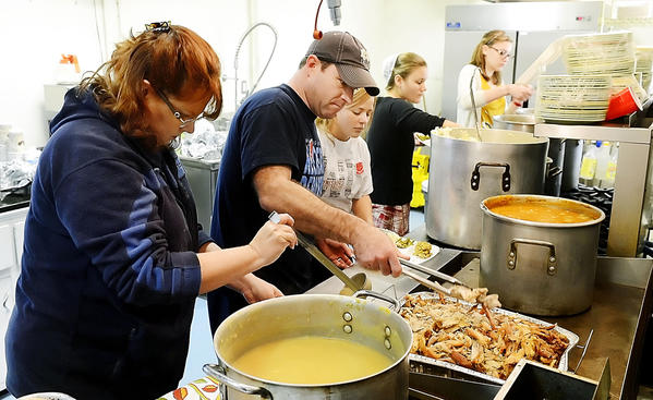 Hagerstown Community College students Amber Sharps, left, Charles Ford, Kayla Payne, Trudy Metzler and Abby Pinkham fill plates in the kitchen Wednesday during the Thanksgiving meal at the Salvation Army in Hagerstown.